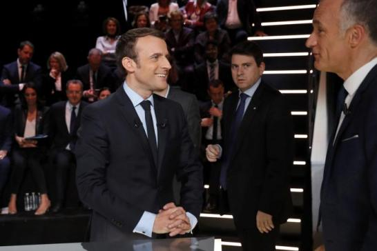 Candidate for the 2017 presidential election Emmanuel Macron arrives for a debate organised by French private TV channel TF1 in Aubervilliers