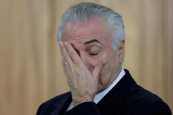 Brazilian President Michel Temer reacts during a credentials presentation ceremony for several new top diplomats at Planalto Palace in Brasilia, Brazil